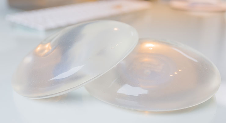 Silicone breast implants on table.