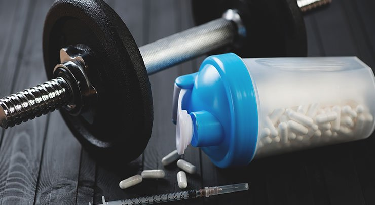 Barbell and steroids for bodybuilders developing gynecomastia.